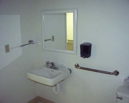 Handicap Bathroom on Handicap Accessible Bathroom With Rails  Sink  Toilet  Sink